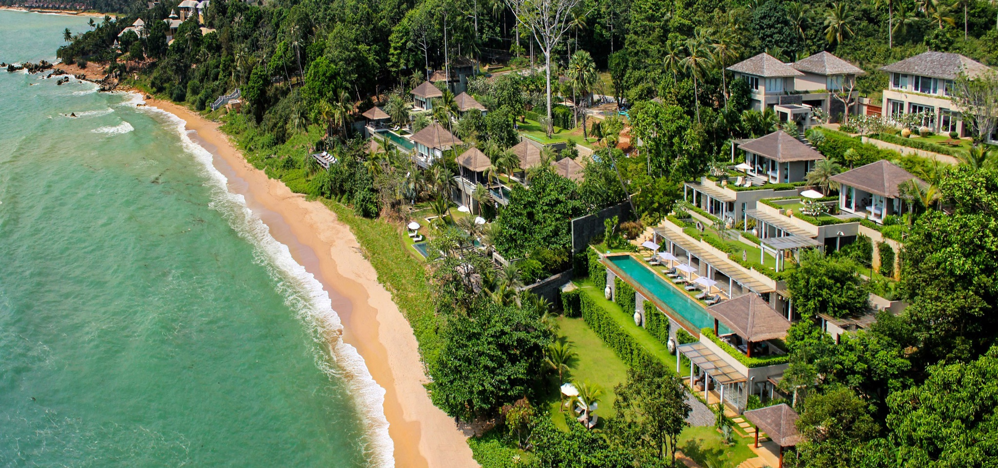 aerial view of an extate of 3 luxury villas in thailand