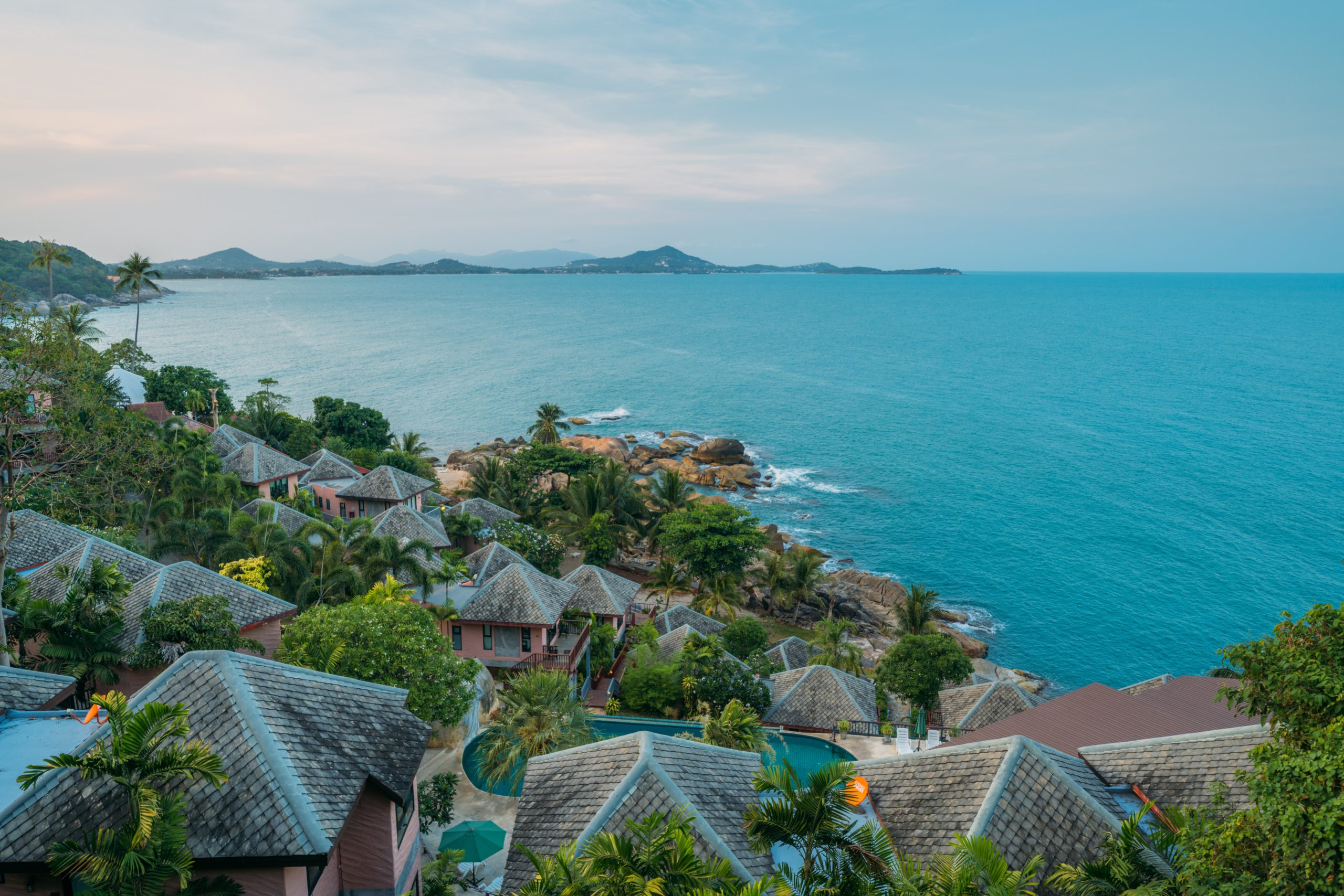 A shot of villas overlooking the blue shore in Koh Samui